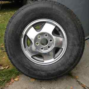 Four winter LT235/R16 tires on rims Prince George British Columbia image 1