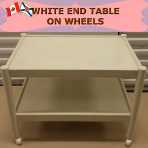 WHITE END TABLE ON WHEELS - CLEAN AND VERY PORTABLE