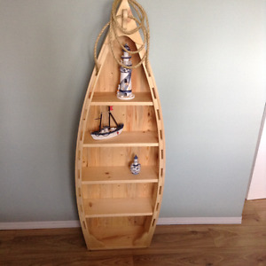 Canoe shelving unit