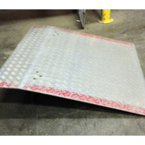 Used dock plate holds 2800 lbs