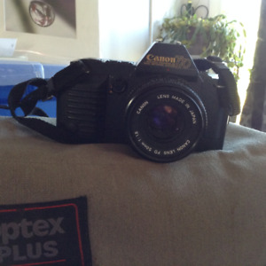 Canon T70 35mm camera and flash