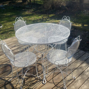 rot iron  table and chairs