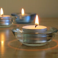 Brand new tea light holders with candles for weddings