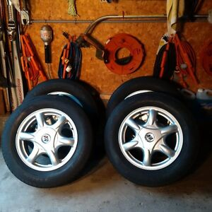 Four alloy rims and tires for a 2002 Buick Regal