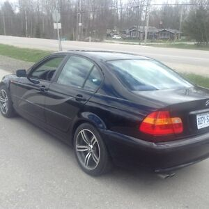 2004 BMW Other Black.   Grey racing stripes Sedan