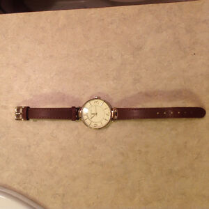 Anne Klein- Large gold face with brown leather strap.