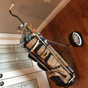 Women's right hand golf clubs and Mitsubisha golf bag and cart