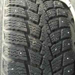 Kuhmo LT235/75R15 studded winter tires on rims.