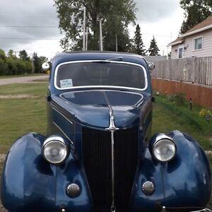 We have a 1936 Ford 2-door Sedan  Custom  $28,000