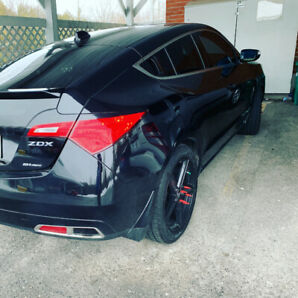 Acura zdx 3 sets of rims all with new tires
