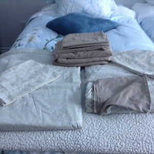 four sets of duvet covers/shams/fitted sheets and pillowcases