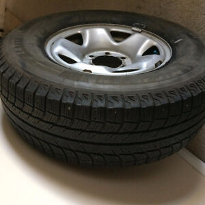 a set of 4 winter tires mounted on rims