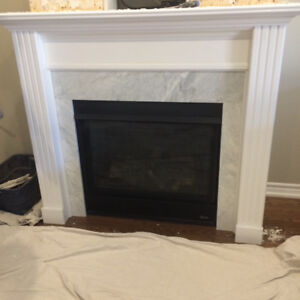 Gas Fireplace Insert, surrounding grey/white marble and mantel