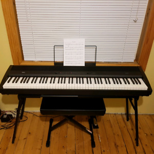 Korg SP 300 88 weighted key stage piano.