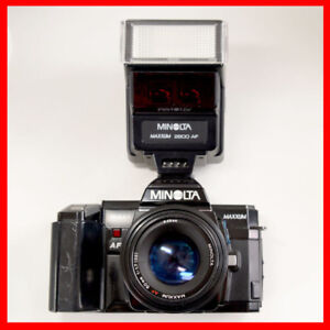 Minolta af7000 film camera + 50mm f1.7 af lens + flash