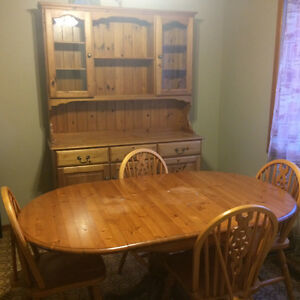 Table chairs and hutch