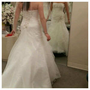 Brand new, never worn or altered wedding dress for sale