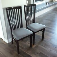 Black dining room table with six chairs