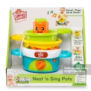 New, in box, Bright Starts Giggling Gourme Nest 'n Sing Pot