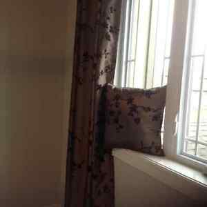 Pair of curtains with matching cushion