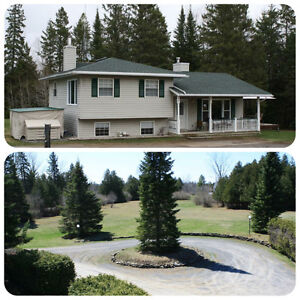 House with large workshop on private 4+ acres!