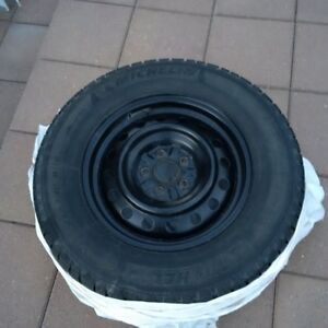 Four Michelin winter tires 225/70/R16 with rims