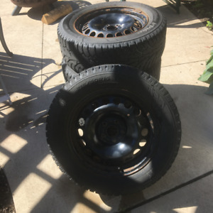 Studded Winter Tires and Rims For Sale - 215-60-16