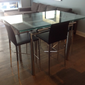 Glass dining room table with leather chairs