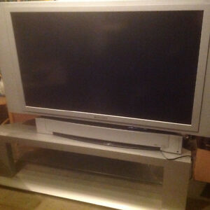 """Panasonic, 50"""" TV with large low slate colour stand"""