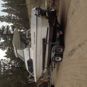 2001 Bayliner 2452 with trailer, new engine, $22,500