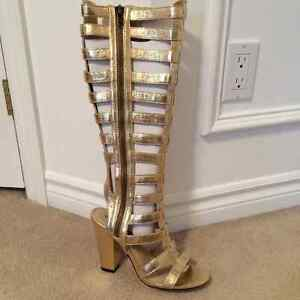 Amazing gold gladiator boots! Brand new in box