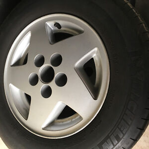 15'' set of Factory Jeep rims and tires P215/70R15