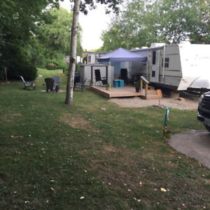 2002 27 Foot Trailer, Deck and Shed included