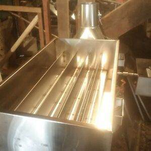 Maple syrup evaporator pans and wood stoves.