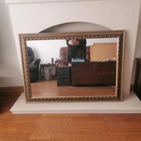 Antique gold mirror, wall mounted, vintage.