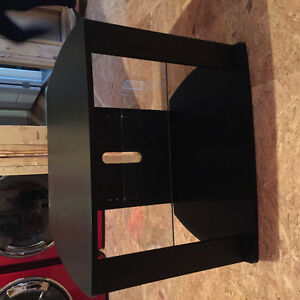 Black TV stand with glass shelf
