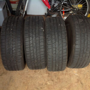 Like new 205/55 R16 all season tires with rims and wheel covers