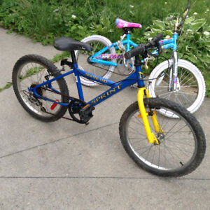 "A 20"" boy BMX speed bike & Next 18"" girl misty pink blue bike"