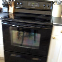 Black Frigidaire Oven top oven and Maytag washer dryer