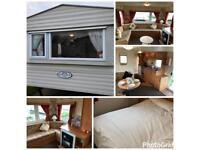 CHEAP STARTER CARAVAN SITED NORTH WALES