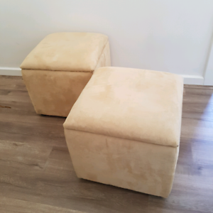 Pair of suede Ottoman storage cubes beside tables