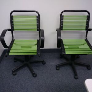 2 green office chairs