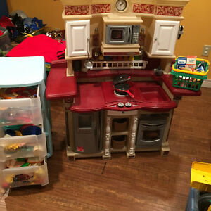 Toy kitchen with play food and dishes