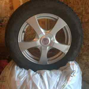 Reduced Price! $750 OBO Like new winter tires and rims