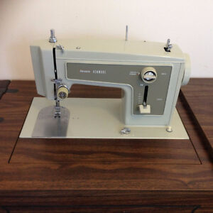 Sewing machine in stand