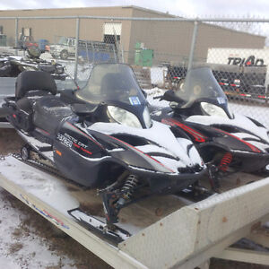Two 660 Turbo Arctic Cat trail sleds and trailer
