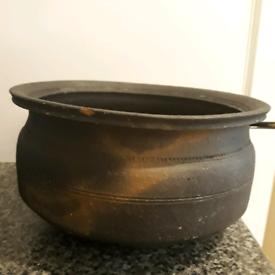 Black clay pottery or handi