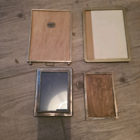4 old photo frames 2 smaller are silver