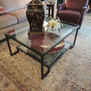 Designer two-tiered glass coffee table in antiqued copper