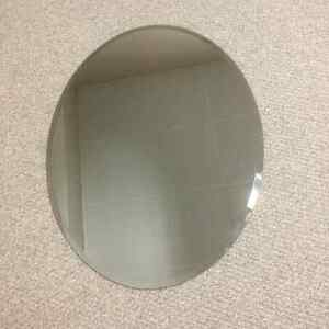 IKEA oval mirrors with beveled edge.